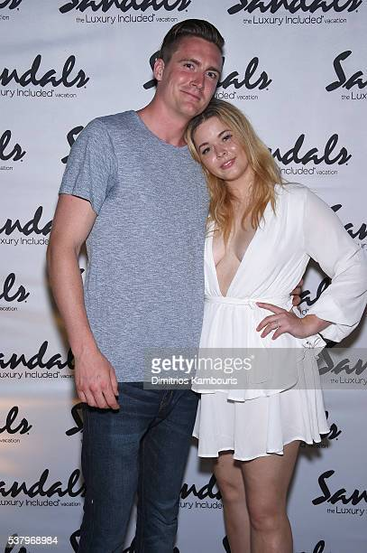 Hudson Sheaffer and Sasha Pieterse attend Happy Hour Golf Pairing And Junkanoo Street Rush during Sandals Emerald Bay Celebrity Golf Weekend on June...