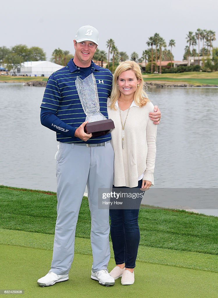 Hudson Swafford and his wife Katherine Wainwright Brandon pose with the trophy during the final round of the CareerBuilder Challenge in partnership with The Clinton Foundation at the TPC Stadium Course at PGA West on January 22, 2017 in La Quinta, California.
