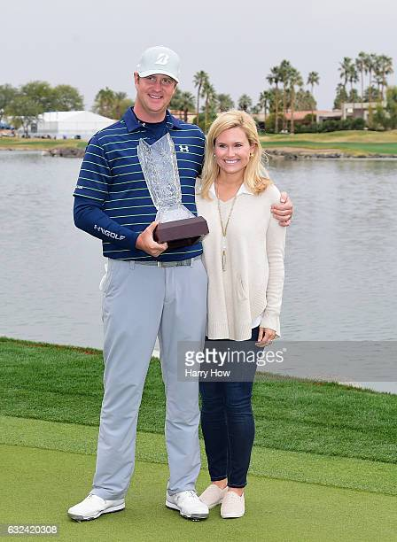 Hudson Swafford and his wife Katherine Wainwright Brandon pose with the trophy during the final round of the CareerBuilder Challenge in partnership...