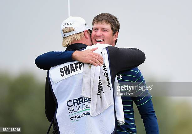 Hudson Swafford celebrates with caddie DJ Nelson during the final round of the CareerBuilder Challenge in partnership with The Clinton Foundation at...