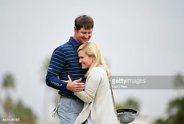Hudson Swafford celebrates with his wife Katherine Wainwright Brandon after putting in to win during the final round of the CareerBuilder Challenge...