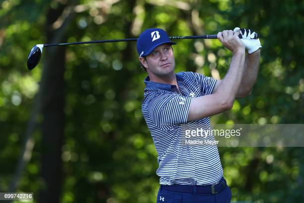 Hudson Swafford of the United States plays his shot from the 12th tee during the first round of the Travelers Championship at TPC River Highlands on...