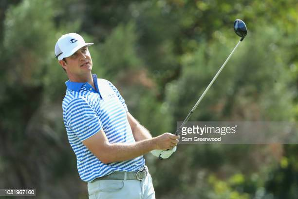 Hudson Swafford of the United States plays his shot from the first tee during the final round of the Sony Open In Hawaii at Waialae Country Club on...