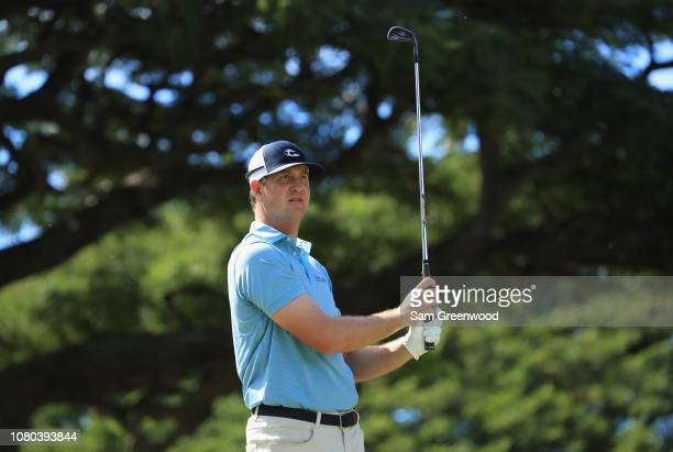 Hudson Swafford of the United States plays his shot from the fourth tee during the first round of the Sony Open In Hawaii at Waialae Country Club on...