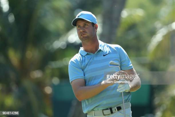 Hudson Swafford of the United States watches his shot from the fourth tee during round three of the Sony Open In Hawaii at Waialae Country Club on...