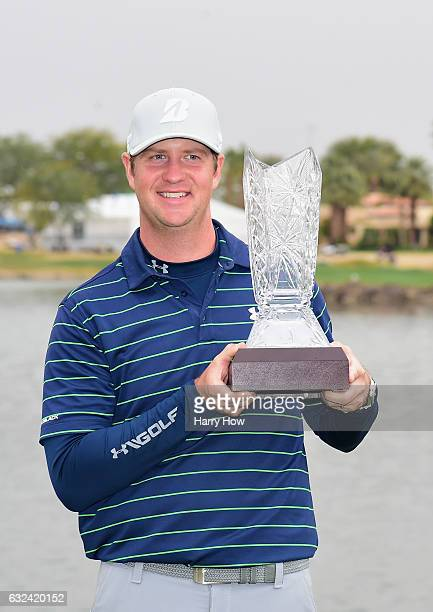Hudson Swafford poses with the trophy during the final round of the CareerBuilder Challenge in partnership with The Clinton Foundation at the TPC...