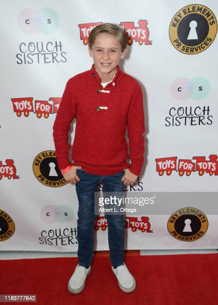 Hudson West attends The Couch Sisters 1st Annual Toys For Tots Toy Drive held onNovember 20 2019 in Glendale California