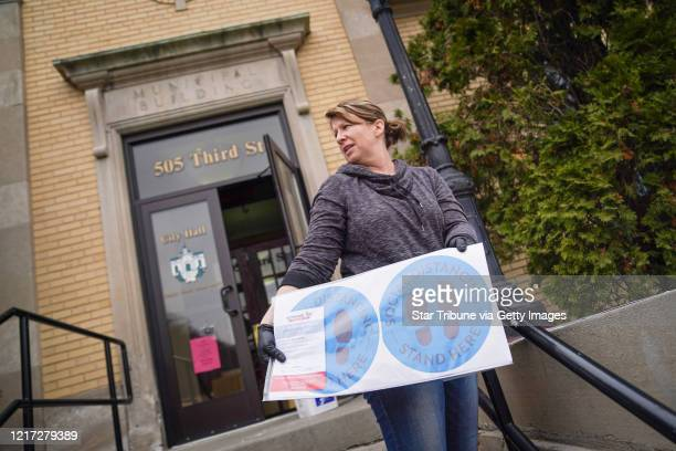 Hudson Wisconsin City Clerk Becky Eggen showed some of the health alert and social distancing signs on Monday April 6 2020 Wisconsin Gov Tony Evers...