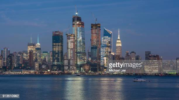 hudson yards development at twilight - new york - hudson yards stock pictures, royalty-free photos & images