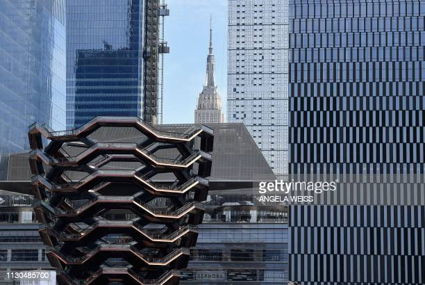Hudson Yards including Vessel is seen prior to the Hudson Yards Grand Opening event on March 14 2019 in New York City With an arts center posh stores...