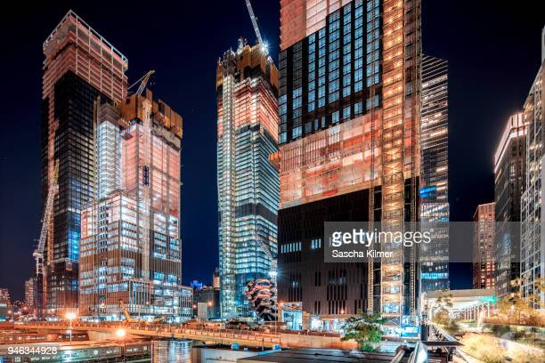 hudson yards, new york, construction site at night - hudson yards stock pictures, royalty-free photos & images