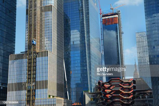 Hudson Yards real estate development, including 'Vessel,' a 150-foot-tall steel structure comprising 50 interconnected flights of stairs, in NYC