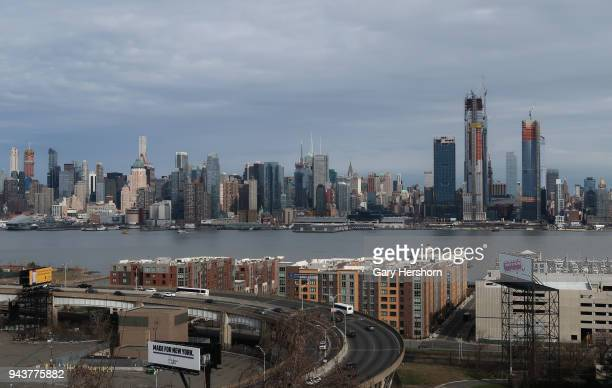Hudson Yards rises on the west side of Manhattan next to the Hudson River in New York City as cars enter and exit the Lincoln Tunnel in New Jersey on...