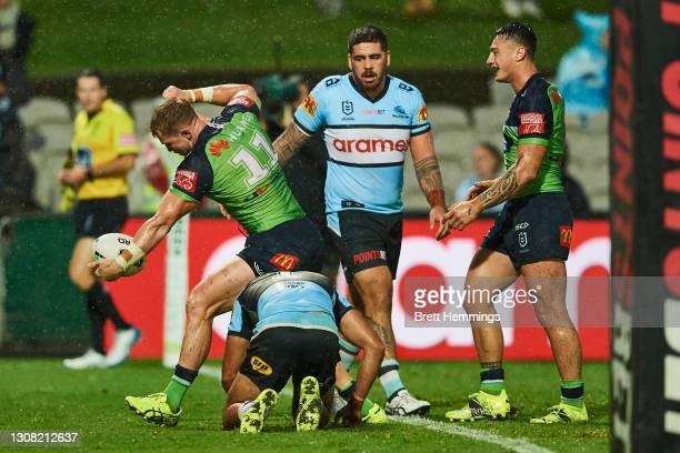 Hudson Young of the Raiders celebrates after scoring a try during the round two NRL match between the Cronulla Sharks and the Canberra Raiders at...