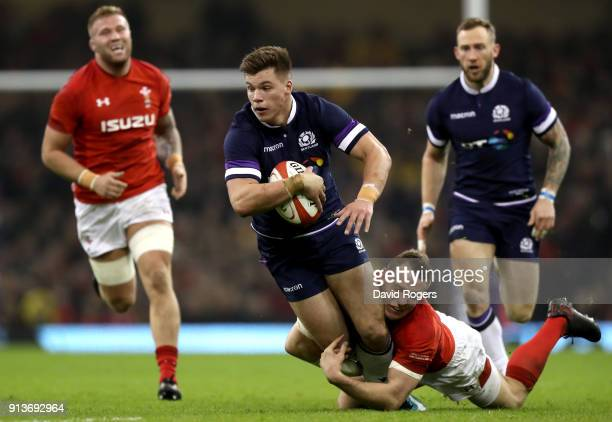 Hue Jones of Scotland is tackled by Hadleigh Parkes of Wales during the Natwest Six Nations round One match between Wales and Scotland at...