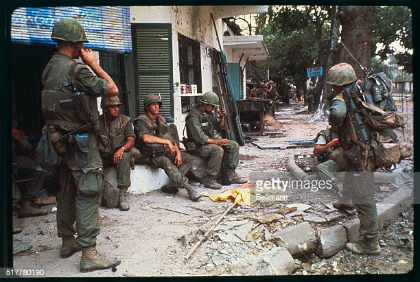 Vietcong attack the 'Tet Offensive' Dodging bullets US Marines take refuge behind trees and a tank on a battlescarred street