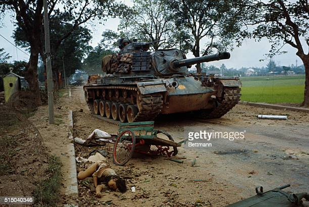 Vietcong attack Two Vietnamese bodies and a crumpled cart lie in the path of a tank during the battle of the Hue