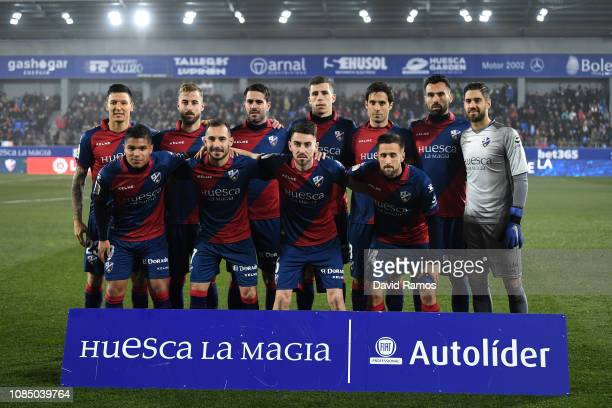 Huesca players pose for a photograph prior to the La Liga match between SD Huesca and Club Atletico de Madrid at Estadio El Alcoraz on January 19...