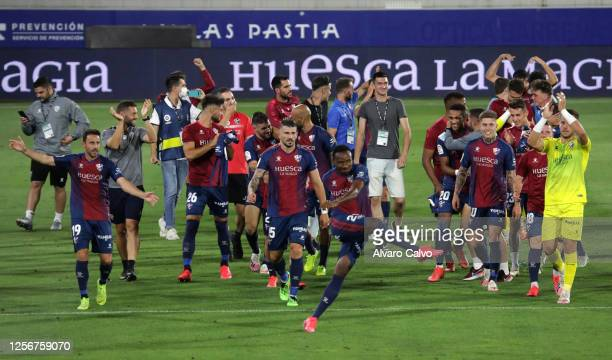 Huesca players react during the La Liga SmartBank match between SD Huesca and Numancia at El Alcoraz on July 17 2020 in Huesca Spain The SD Huesca...
