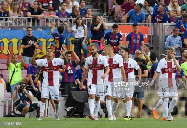 SD Huesca's Colombian forward Cucho Hernandez celebrates scoring a goal during the Spanish league football match between FC Barcelona and SD Huesca...