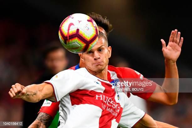 SD Huesca's Italian forward Samuele Longo eyes the ball during the Spanish league football match Club Atletico de Madrid against SD Huesca at the...