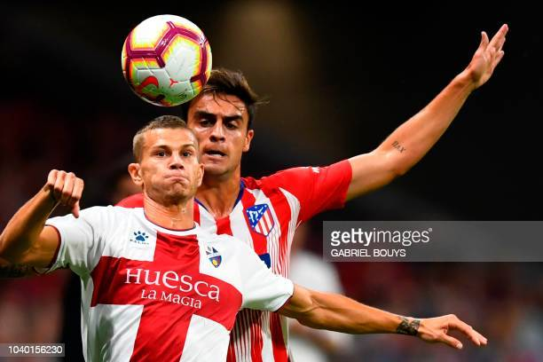 SD Huesca's Italian forward Samuele Longo vies with Atletico Madrid´s Spanish mildfielder Carlos Isaac during the Spanish league football match Club...