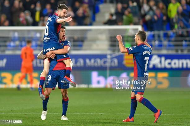 Huesca's players celebrate their second goal during the Spanish league football match between SD Huesca and Sevilla FC at the El Alcoraz stadium in...