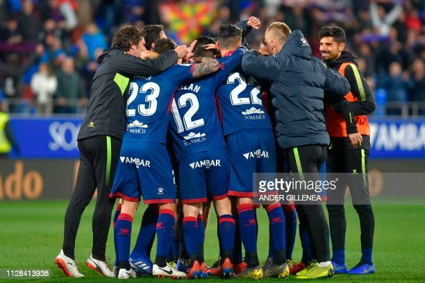 SD Huesca's players celebrate their second goal during the Spanish league football match between SD Huesca and Sevilla FC at the El Alcoraz stadium...