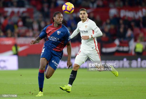 SD Huesca's Portuguese defender Ruben Semedo fights for the ball with Sevilla's Portuguese forward Andre Silva during the Spanish league football...