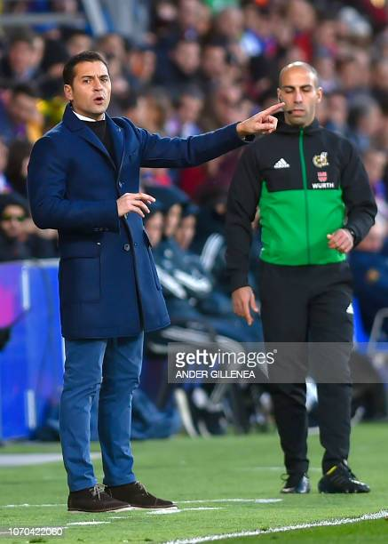 Huesca's Spanish coach Francisco Rodriguez gestures during the Spanish league football match between SD Huesca and Real Madrid CF at the El Alcoraz...