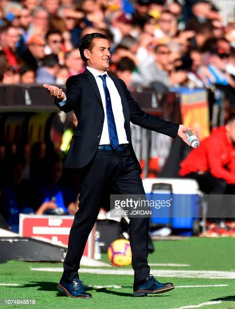 Huesca's Spanish coach Francisco Rodriguez gestures during the Spanish League football match between Valencia CF and SD Huesca at the Mestalla...