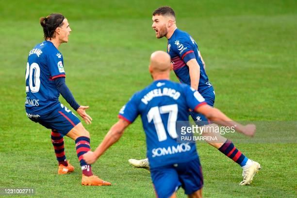 Huesca's Spanish defender Javi Galan celebrates with Huesca's Spanish midfielder Jaime Seoane after scoring a goal during the Spanish league football...