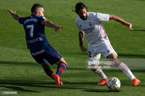 Huesca's Spanish midfielder David Ferreiro challenges Real Madrid's Spanish midfielder Isco during the Spanish League football match between Real...