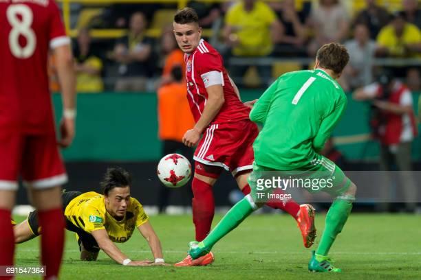 Hueseyin Bulut of Dortmund Matthias Stingl of Munich and Goalkeeper Ron Thorben Hoffmann of Munich battle for the ball during the U19 German...