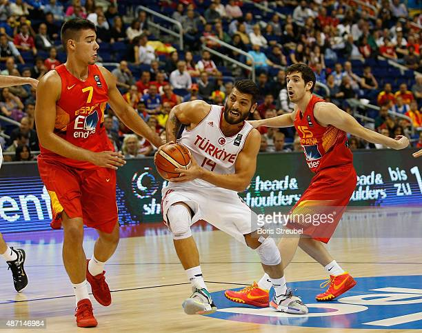 Hueseyin Koeksal of Turkey is blocked by Guillermo Hernangomez and Guillem Vives of Spain during the FIBA EuroBasket 2015 Group B basketball match...