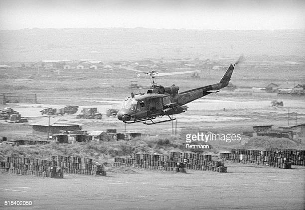 A U S Huey helicopter equipped and armed with the 'tow' missile antitank weapon takes to the air over Pleiku on May 4th The new missiles are being...