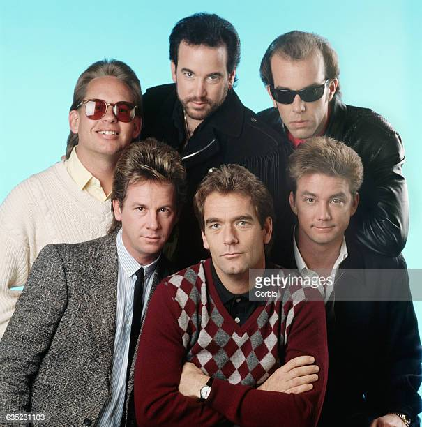 Huey Lewis and his bandmates Mario Cipollina Johnny Colla Bill Gibson Chris Hayes and Sean Hopper pose together