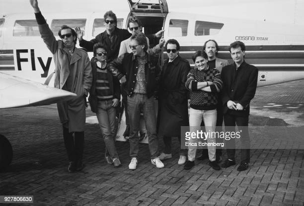 Huey Lewis and The News at an airfield boarding a flight to Newcastle to appear on a TV show London 1982