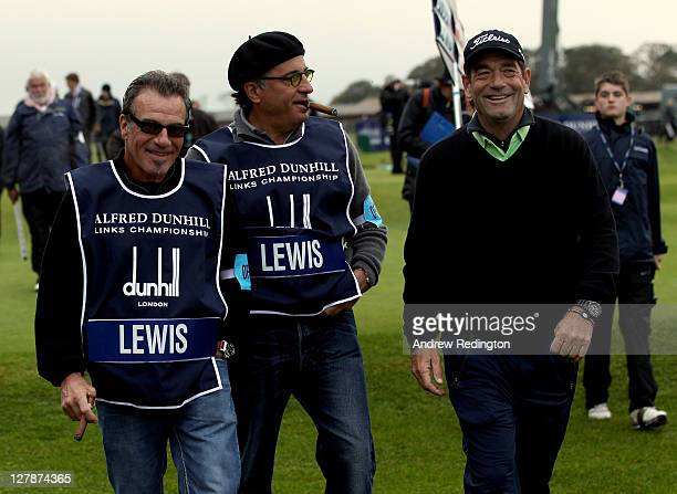 Huey Lewis is supported by Andy Garcia and Rico Torres during the final round of The Alfred Dunhill Links Championship at The Old Course on October 2...