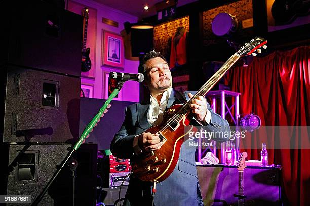 Huey Morgan of the Fun Lovin' Criminals performs at Hard Rock Cafe Old Park Lane in aid of 'Pinktober' breast cancer awareness on October 14 2009 in...