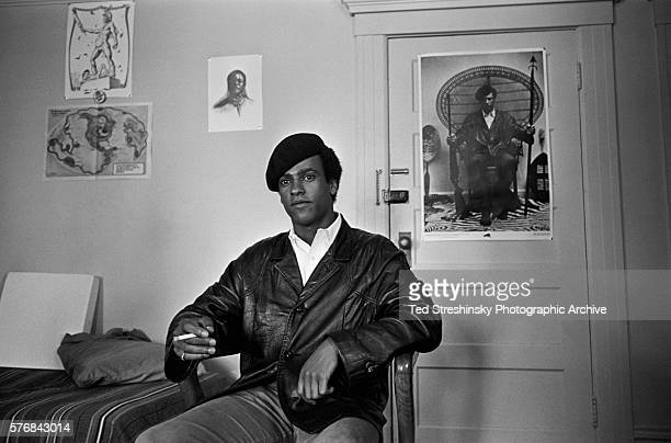 Huey Newton founder of the Black Panther Party sits in a chair and smokes a cigarette at party headquarters in San Francisco