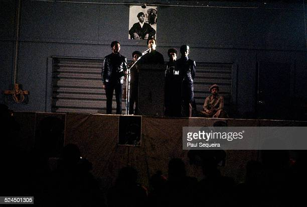 Huey Newton with other Black Panther Party members surrounding him speaks at the Chicago Coliseum Chicago Illinois April 1969