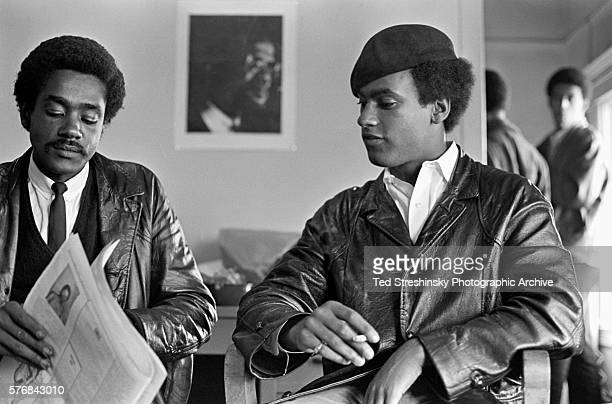 Huey Newton[r], founder of the Black Panther Party, sits with Bobby Seale at party headquarters in San Francisco.