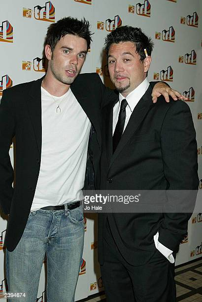 Huey of the band Fun Lovin' Criminals and Dave Berry host of TRL attend the launch of MTV's 'TRL' August 12 2003 at the In Out Club in Piccadilly in...