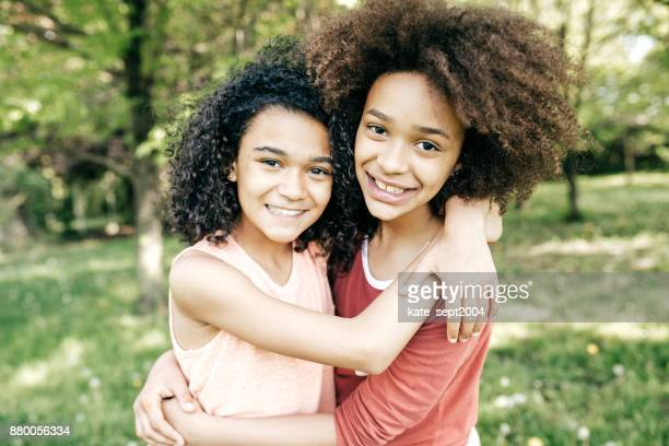 hug for friend - sister stock pictures, royalty-free photos & images