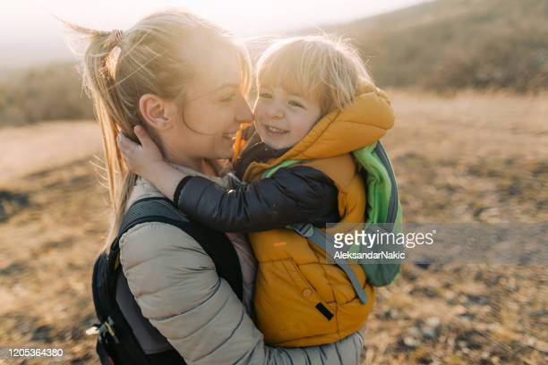 hug for my mom - active lifestyle stock pictures, royalty-free photos & images