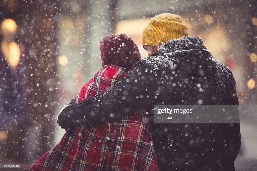 Hug in snowfall : Stock Photo