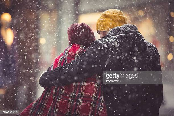 Hug in snowfall