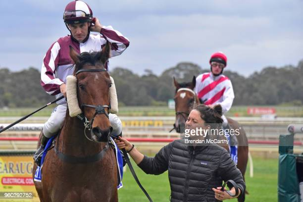 Huge Action ridden by Luke Currie returns to the mounting yard after winning the Cola Solar BM64 Handicap at Bendigo Racecourse on May 20 2018 in...