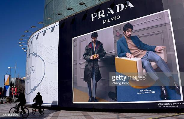 Huge advertisement of luxury brand in Wangfujing business street Because of economy development slowdown and anticorruption in China demand for...